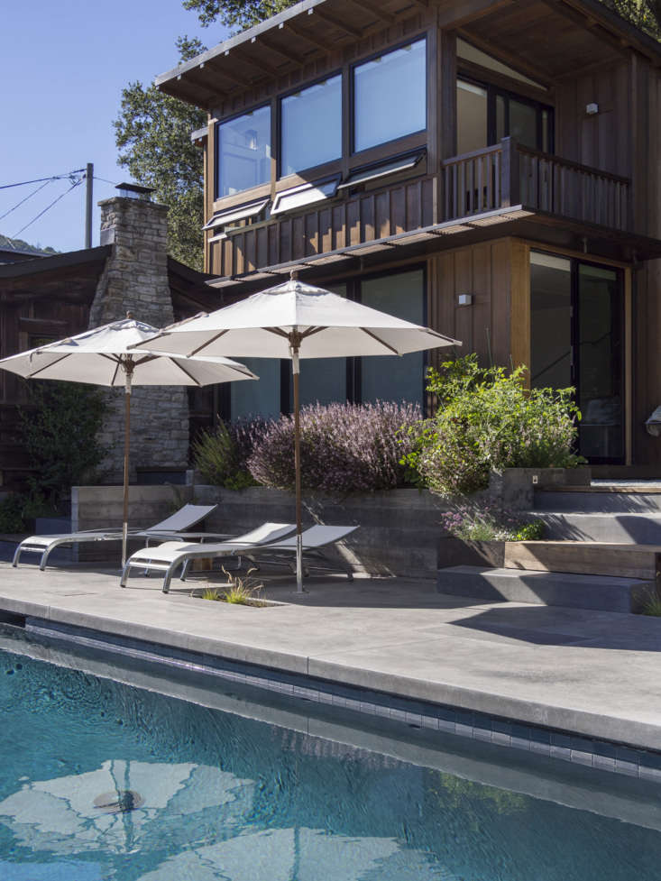 Two in-ground umbrellas provide poolside shade as needed.