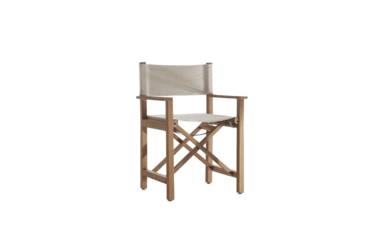 From designer James Perse and made in the US, a teakCross Creek Directors Chair is covered in an all-weather fabric; for more information and pricing, see James Perse.