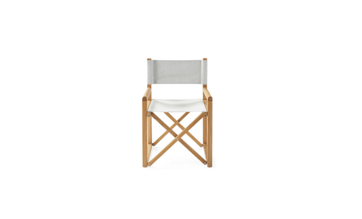 Covered in all-weather Sunbrella fabric, a solid teakDirectors Chair chair is \$498 from Serena &Lily.