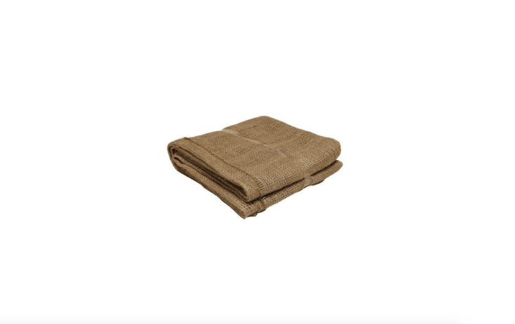 Measuring 80 by 80 inches, a length of Natural Burlap Landscape Fabric can be used as a wind break, frost protection, or a shade cloth to protect tender seedlings. It is \$7.98 from Home Depot.