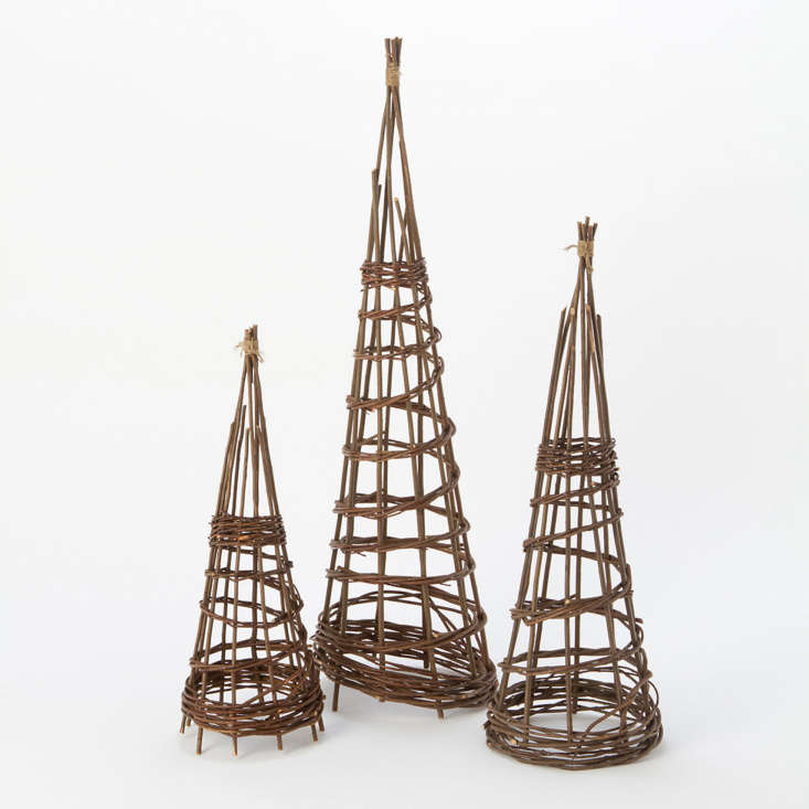 Garden tepees are useful structures for training vines such as clematis. Originally available in three sizes, a Woven Willow Obelisk currently is in stock only in a small size. It is\28 inches high and \$\18 from Terrain.