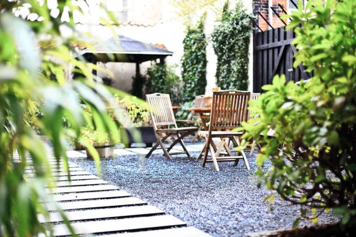 Narrow and long, stone paver strips mimic the look and feel of a beach boardwalkin the garden at Bertrams Guldsmeden hotel in Copenhagen.