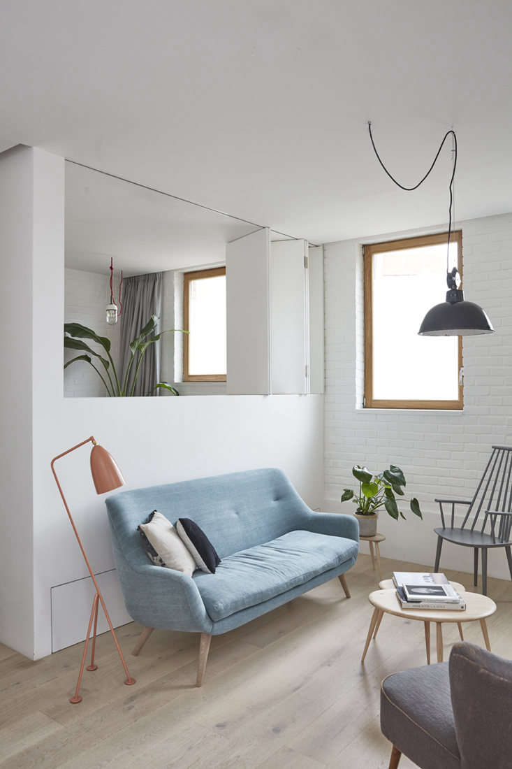 In a small, reconfigured mews house in Hackney, London (for a family of four), architect Craig Hutchinsonre-jiggered the interiors, knocking down most walls in favor of half-walls, so light could pass through. Photograph by Helen Cathcart.
