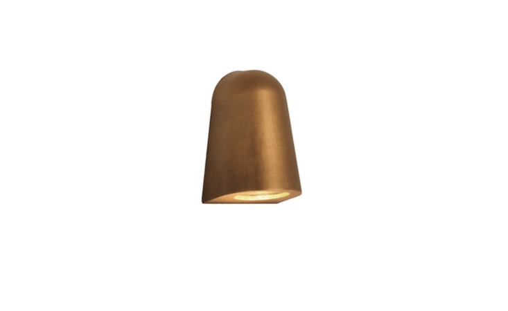 A downlight Mast Light, available in four finishes including antique brass (shown), has a dimmable switch. For more information and prices, visit Astro Lighting.