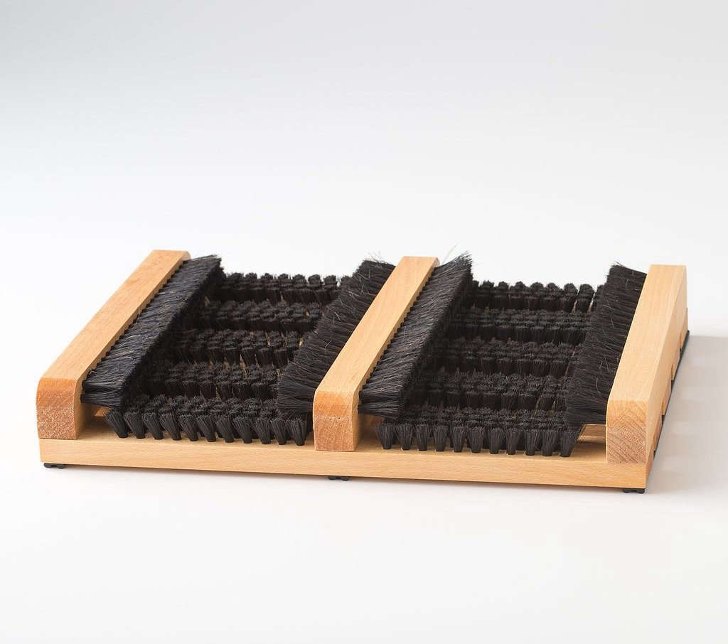 Made by hand by a family-owned factory in Germany, a German Boot Brush is a front porch staple made from oiled beechwood with horsehair bristles; $68.