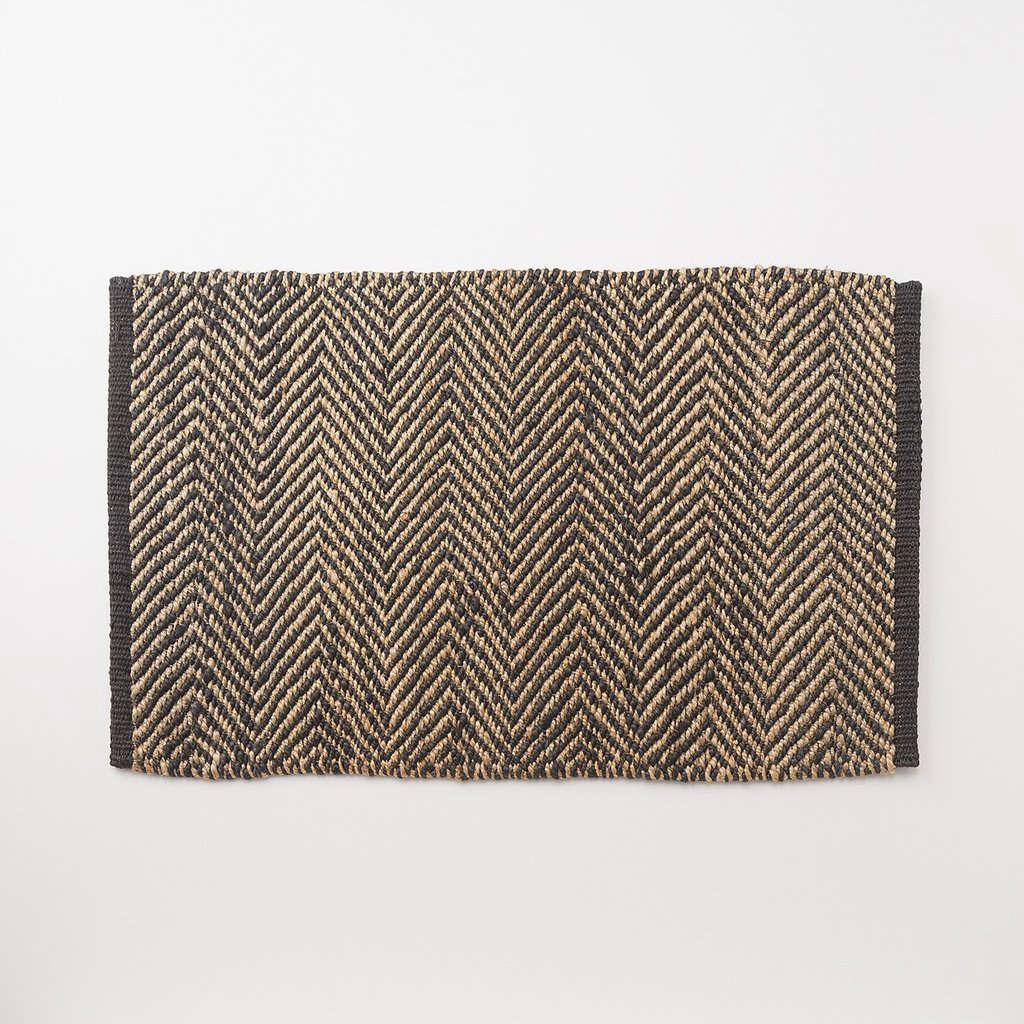 Made of hemp fibers by a fair-trade cooperative, a durableHerringbone Door Mat has an African-inspired pattern; $9.