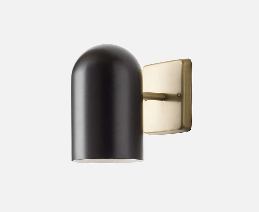 AnAllegheny Indoor/Outdoor Sconce is vigorously tested to withstand wind and rain, and is available in black, white, and a 70s-inspired butterscotch yellow; $9.