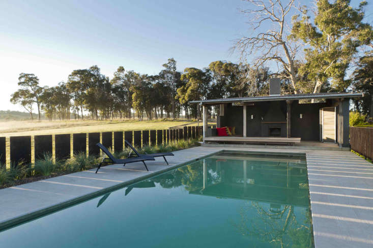 Surrounding the pool is a tiled concrete deck.