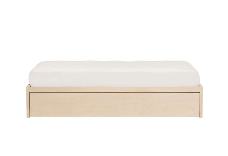 AThompson Trundle Bed(\$\1,049) from Urban Green Furniture is paintedin Farrow & Ball Slipper Satin to match the walls of a guest room.