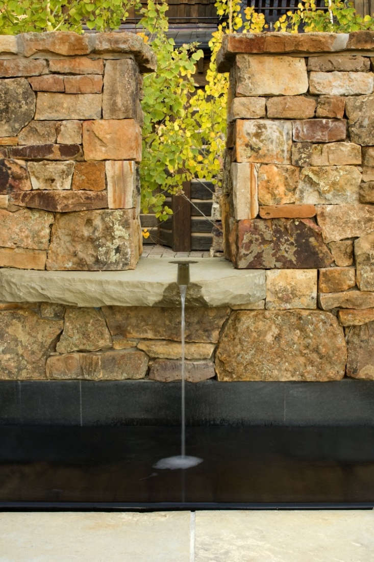 &#8\2\20;From the courtyard side, a slender channel of water spills on to a single concave slab of stone.&#8\2\2\1;