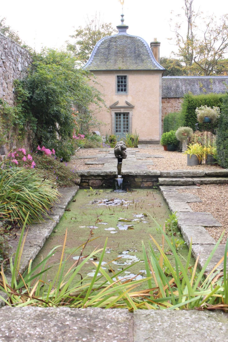 Two pavilions sit at either end of the walled garden, separated by a rill and two ponds.