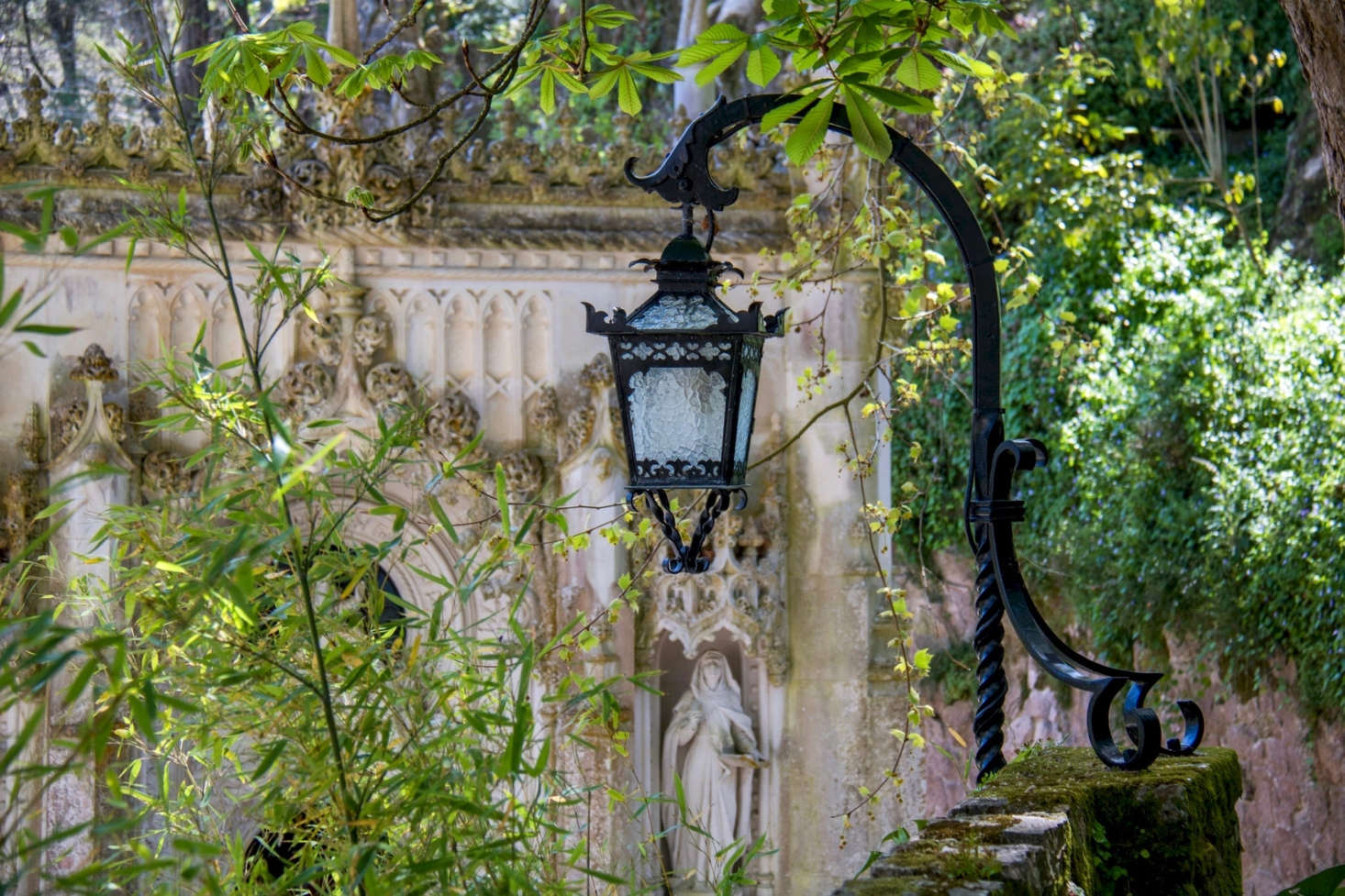 A monochromatic green backdrop adds drama to an ornate wrought iron lantern at the Quinta da Regaleira estate in Sintra. Photograph by Susanne Nilsson via Flickr.