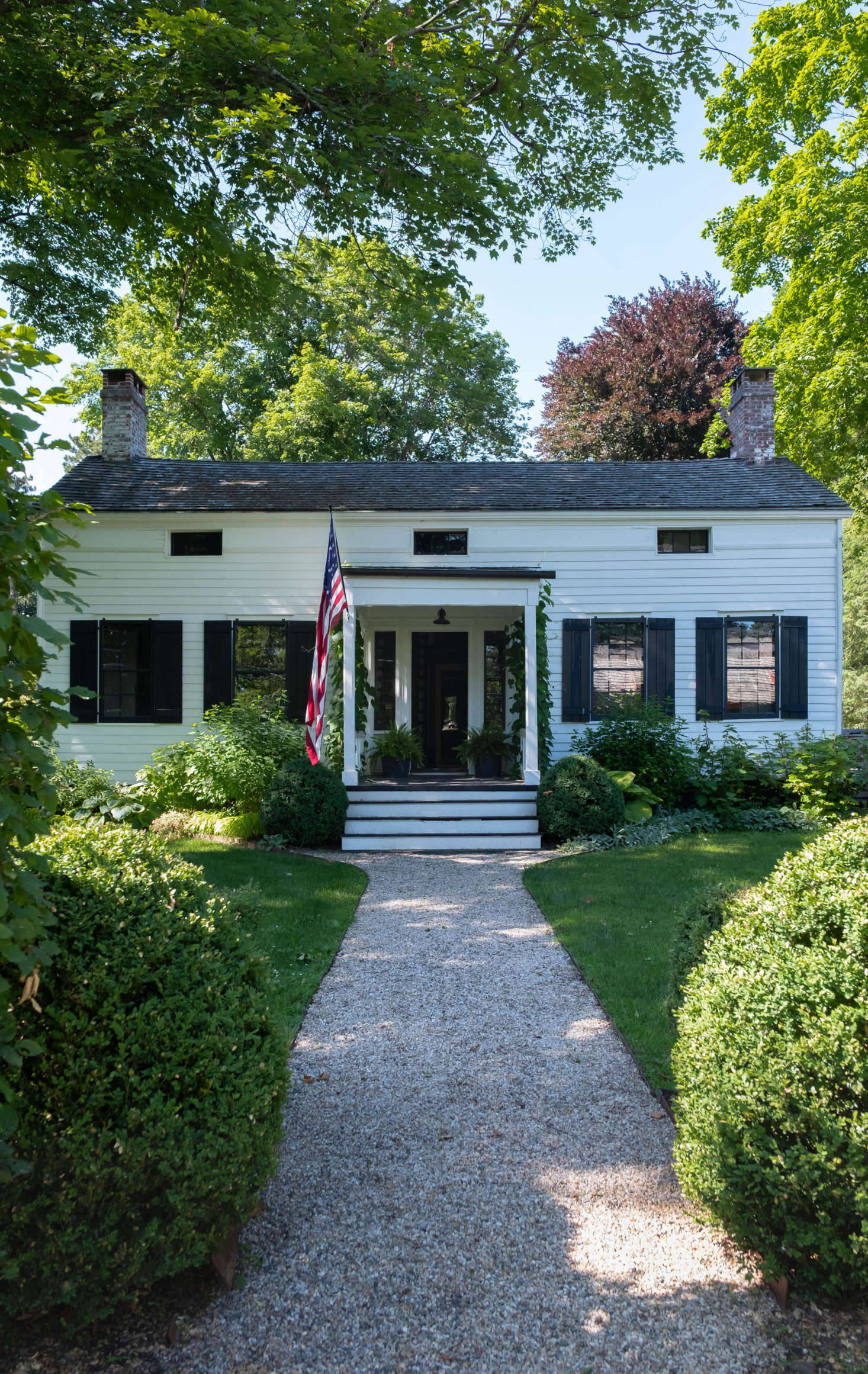 The circa-30 house is set back from a main street in Claverack, where tall hedgerows abut the road and conceal the historic houses and sprawling gardens behind.