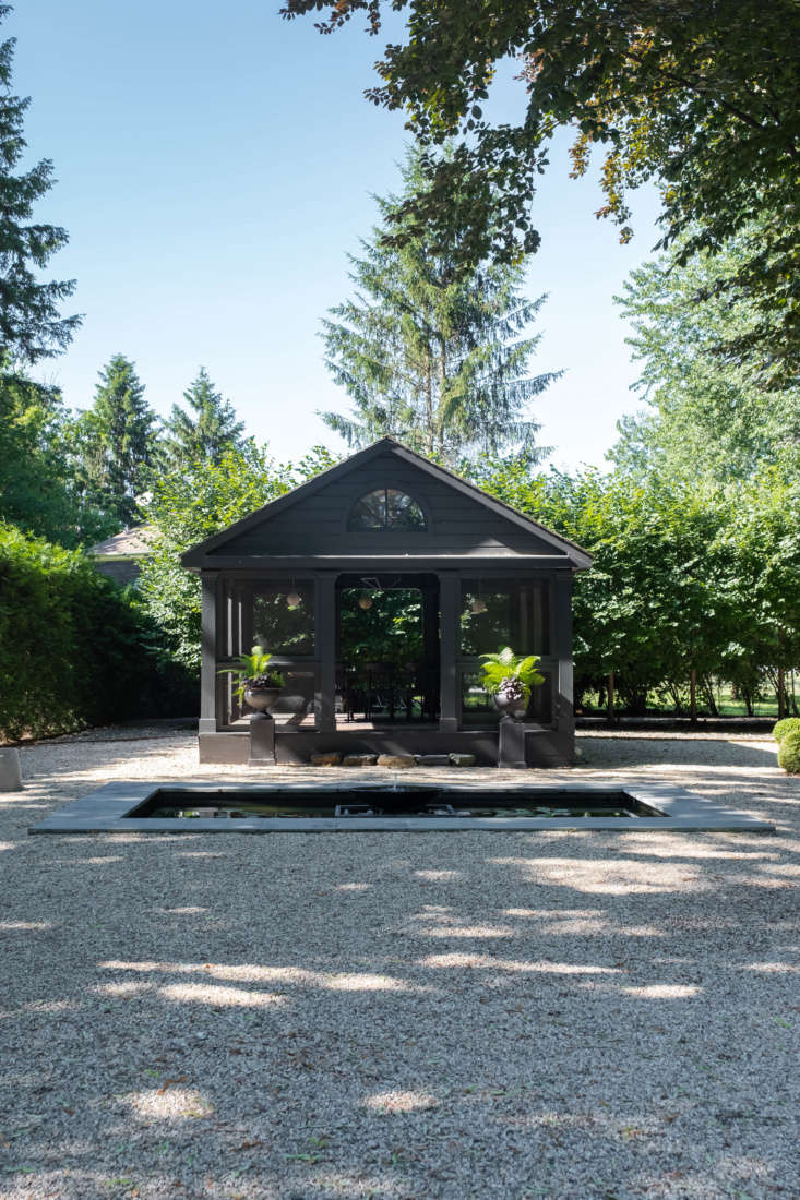 Beyond the hedges lies thegarden&#8\2\17;s piece de resistance: a long, formal gravel garden, centered by a screened outbuilding (for long, warm-weather dinners) and a shallow reflecting pool.