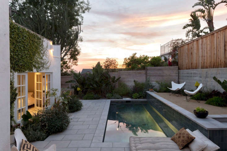 In costume designer Gordana Golubovic's luxe, secluded LA backyard, a poured-concrete wall supports a vertical-slat wooden fence. See more at Garden Visit: Spanish Colonial-Style Made Modern in LA. Photograph by Lauren Moore.