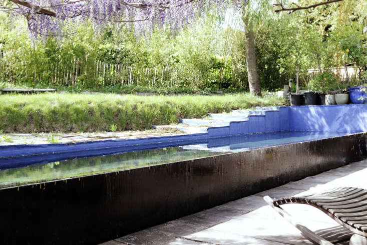 """The exterior of the pool is painted black and the inside is painted a Yves Klein–inspired shade of blue. """"I paint it every year,"""" he says."""