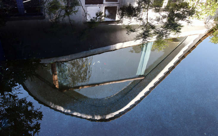 The house, reflected in the pool.