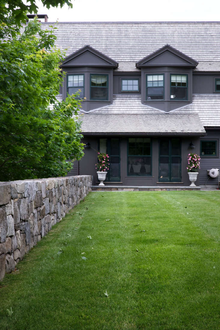 In front of the shingle-style house built byAlbert, Righter & Tittman Architects, a line of sugar maple trees and another newly built fieldstone wall shelter a generous lawn, the main outdoor living and recreation space.