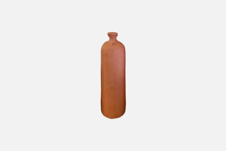 A\1\2-Inch Olla Bottle is designed with unglazed terracotta and a glazed top to keep water from evaporating above ground. Bury the olla beneath the soil for it to work best; \$\23 at Cutting Edge Ceramics on Etsy.