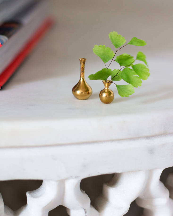 Maidenhair fern fronds in tiny vases from Almeda Pottery.