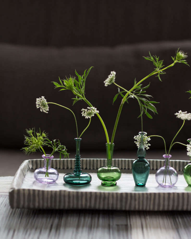 Handblown miniature vases from Kiva Ford each hold a stem of Queen Anne&#8