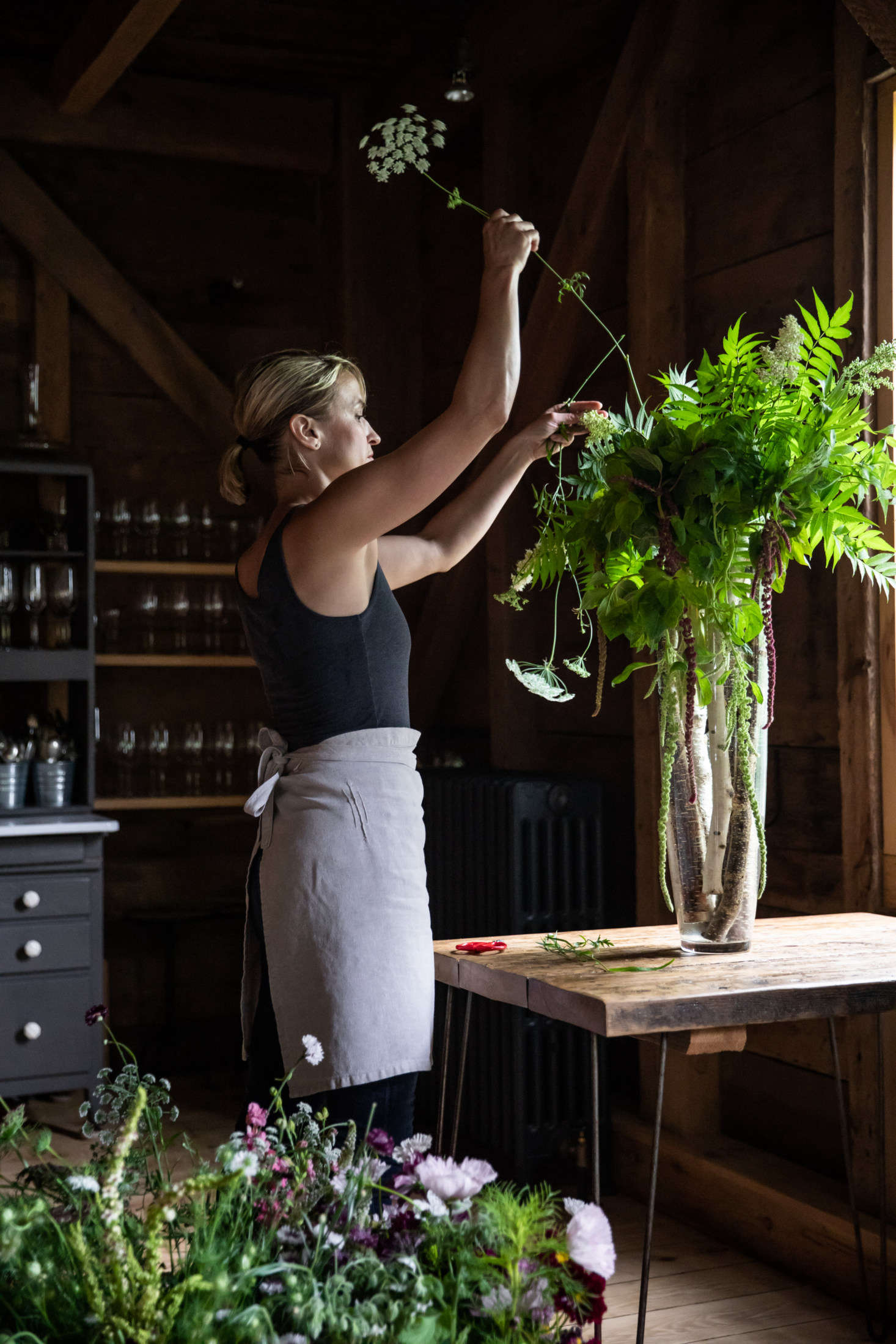 Most of the fittings at the Lost Kitchen are budget and vintage finds, from the antique china to the retro refrigerator and sink in the open kitchen. French&#8