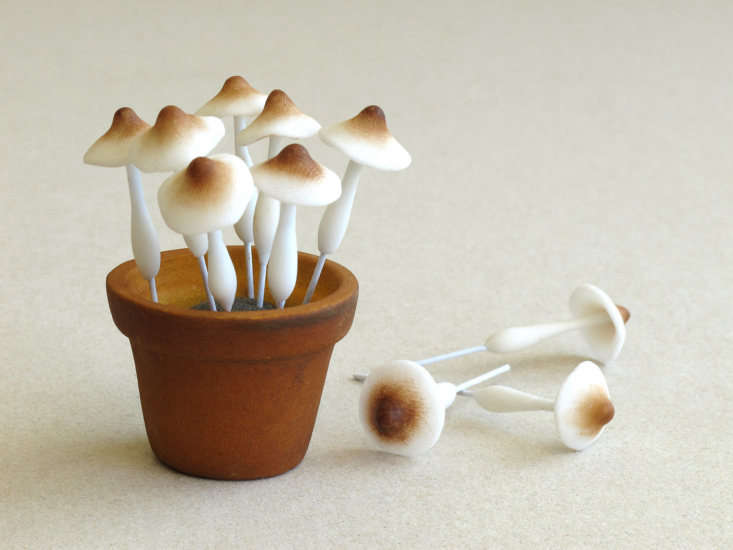 A set of \10 miniatureClay Mushrooms made of air-dried clay and wire stems is \$7.50 from Squishnchips via Etsy.