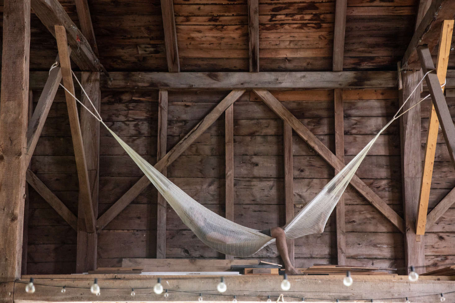 A hammock hung in the loft of the barn, for rare moments of rest.