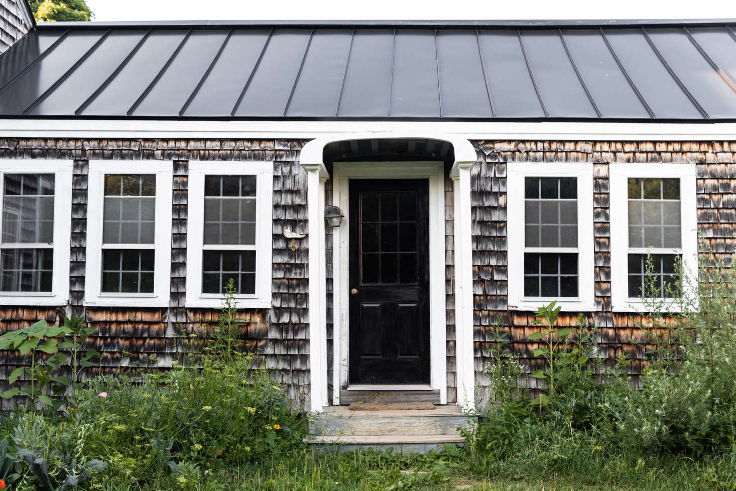 "A major upgrade: the standing-steam metal roof, added last summer. ""It's a common, practical option in this climate,"" Lafleur says. ""In the winter, when the sun hits the roof, any accumulated snow slides down in these neat sheets."" (See Hardscaping src="