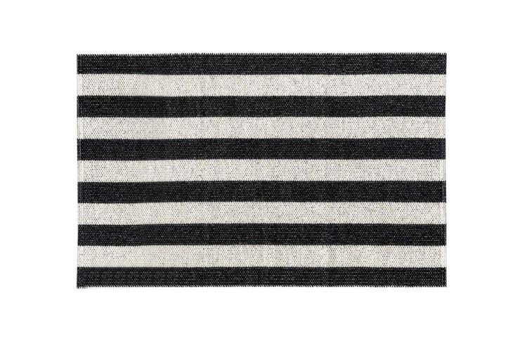 From Nordic Nest, the Woods Rug Black in a classic black-and-white stripe made of PVC and polyester. Prices range from \$\1\29 to \$\24\1 at Scandinavian Design Center.