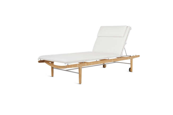 The Norm Architects Finn Chaise is made of a sustainably harvested teak frame with Sunbrella cushions; $loading=