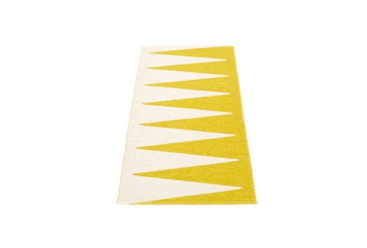 One of our favorite sources for plastic Swedish rugs, Pappelina has a variety of appealing designs made from phthalate- and toxic-free PVC material. The Vivi Rug, shown in mustard and vanilla, is priced between \$60 and \$433 at Fjorn.
