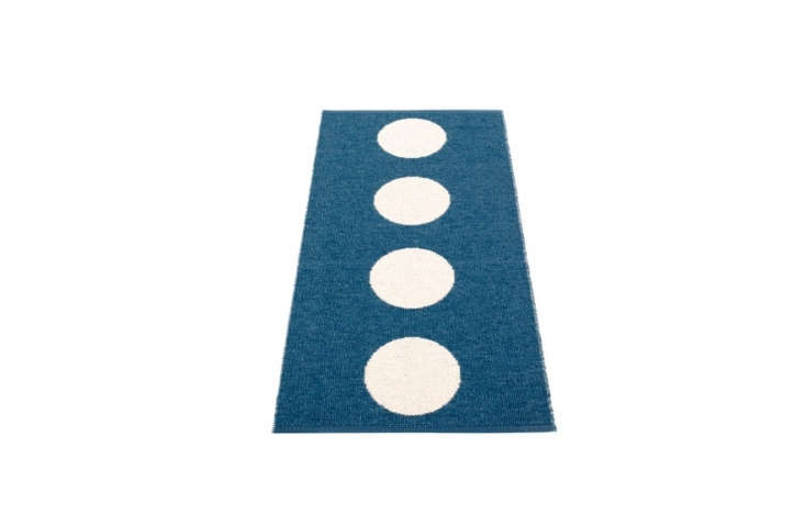 Pappelina&#8\2\17;s Vera Plastic Rugs, in ocean blue and vanilla, are \$93 to \$433 at Fjorn.