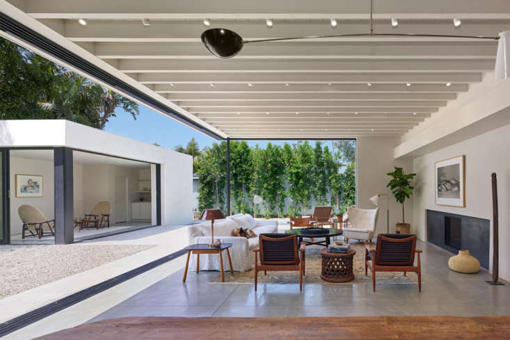 In West Hollywood, a house by Standard Architecture for designer-builder Leigh Herzighas a \10-foot-high tongue-and-groove ceiling with exposed beams and glass window walls; framed with bronze-anodized aluminum, the glass slides into wall pockets and disappears from view. Photograph by Benny Chan.