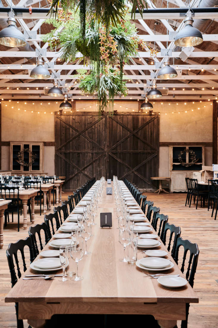 The high-ceilinged event space has reclaimed wood floors, farmhouse tables, and string lights someone else already hung for you. Guest capacity: 0.