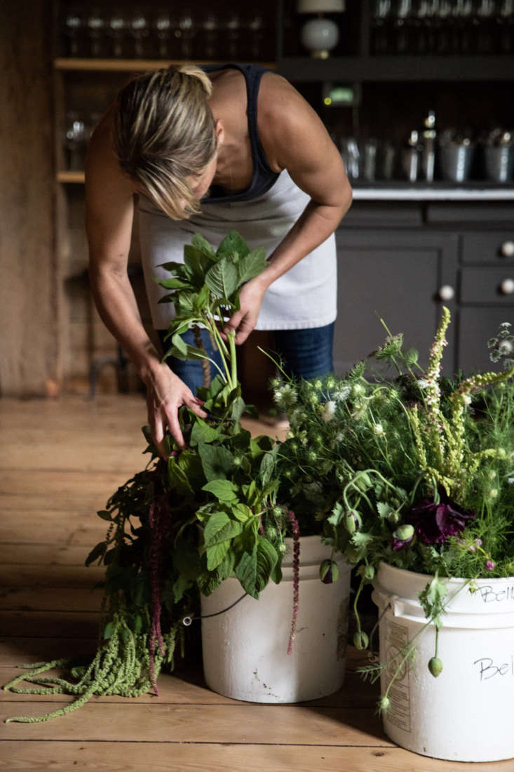 French steps away from the stove to see what flowers she has to work with today. Ashley Savage, one of the servers from the nearly-all-female team at the restaurant, brings buckets of flowers from her farm, Belladonna Floral in Knox, Maine.