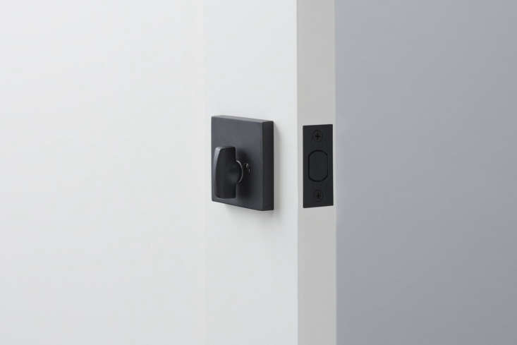 The Emtek Berlin Deadbolt Turn Knob is available in flat black (shown) and Satin Brass; \$60 each at Schoolhouse.