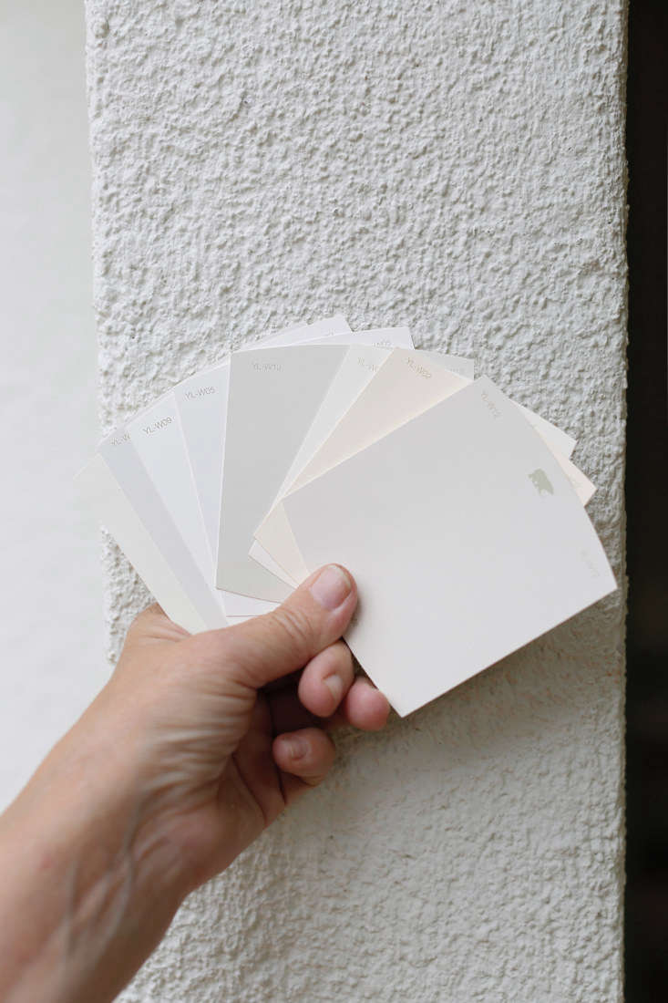 At her local Home Depot, Michelle found eight shades of off-white and beige paint that looked like promising matches. To choose, she brought home swatches and held them up against the stucco at different times of day because as the light changes, so can paint color. The winner: Behr&#8