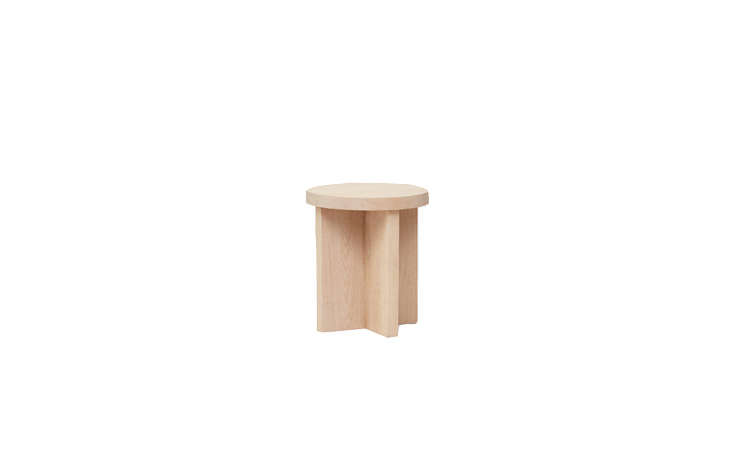 """The sturdy Jenni Kayne Oak Side Table (\$\1,\295) has """"an intentionally unfinished appearance"""" and measures \2\1.5 inches tall."""