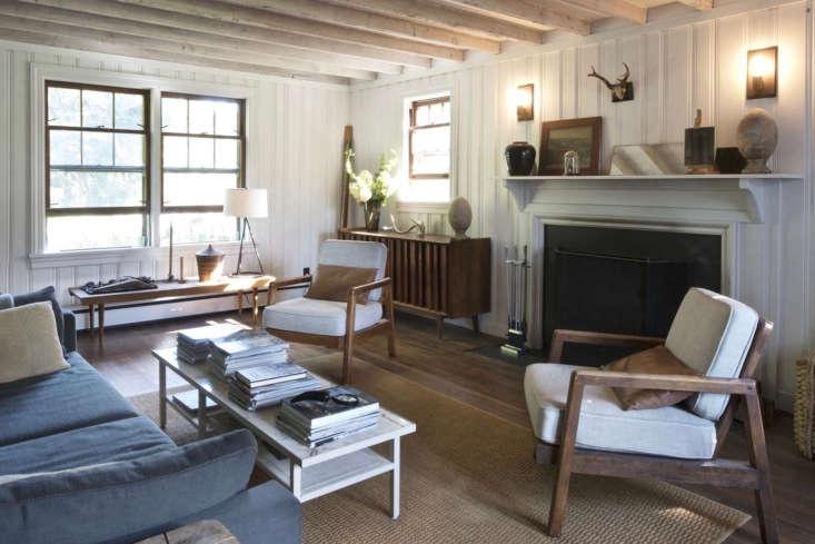 Hydrangeas light up a far corner in a living room of a farmhouse that Brooklyn-based architectRoberto Sosa and his partner, Jeffrey Coe, own in upstateNew York. Photograph byMylene Pionilla.