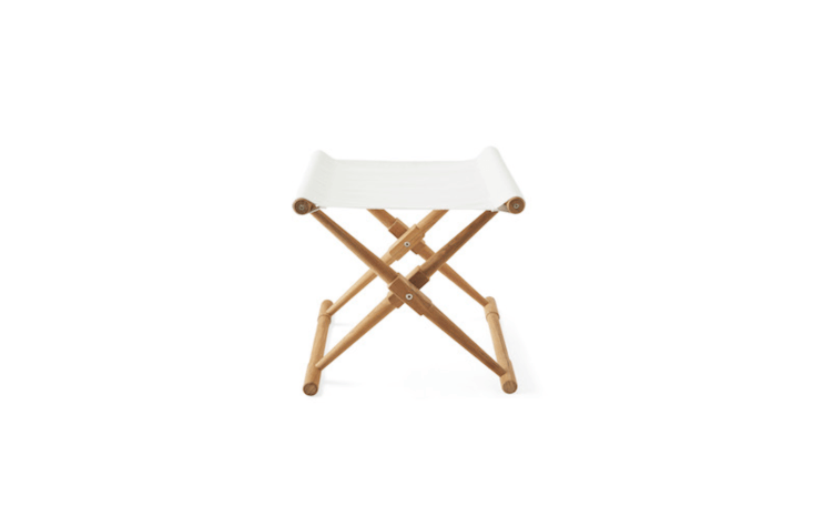 A Teak Camp Stool available in three colors (shown in white) has a canvas seat made of double-sided, all-weather Sunbrella fabric; $