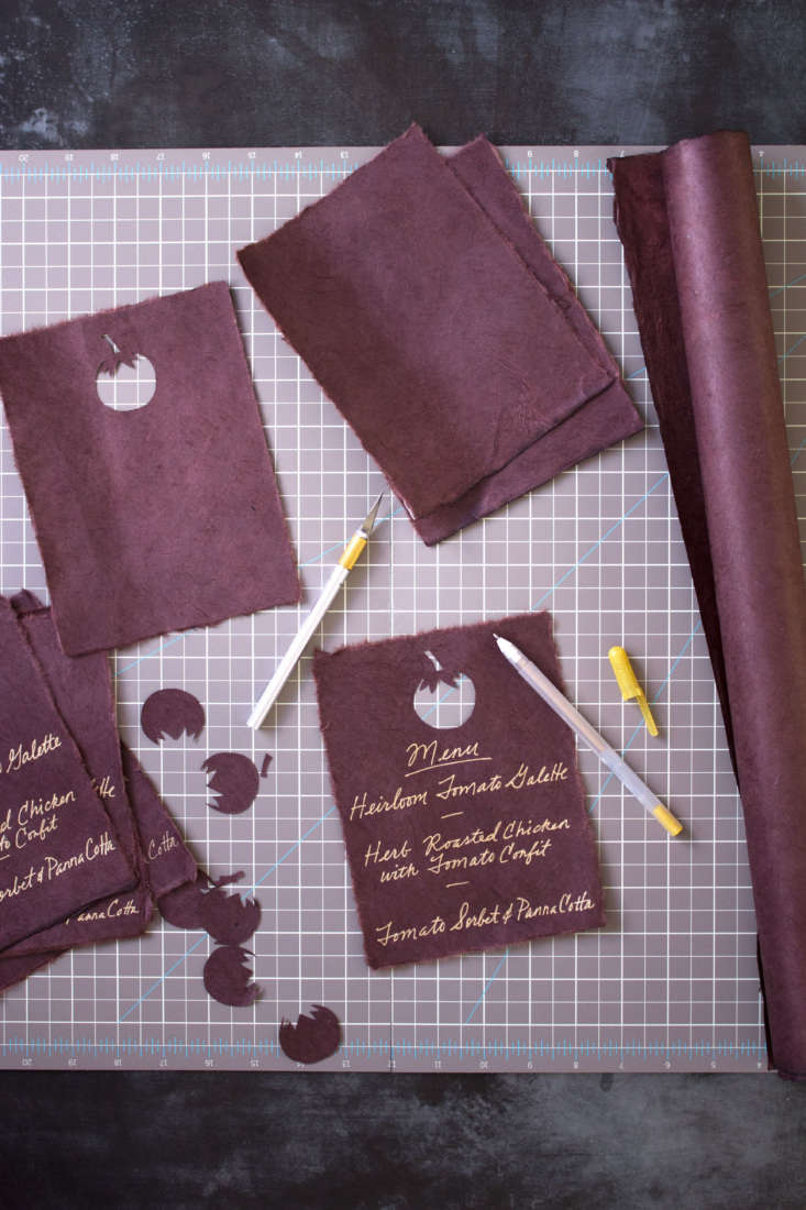 At each place is a menu written in gold gel pen on chocolate brown rice paper. (See below for a template you can use to recreate the look.)