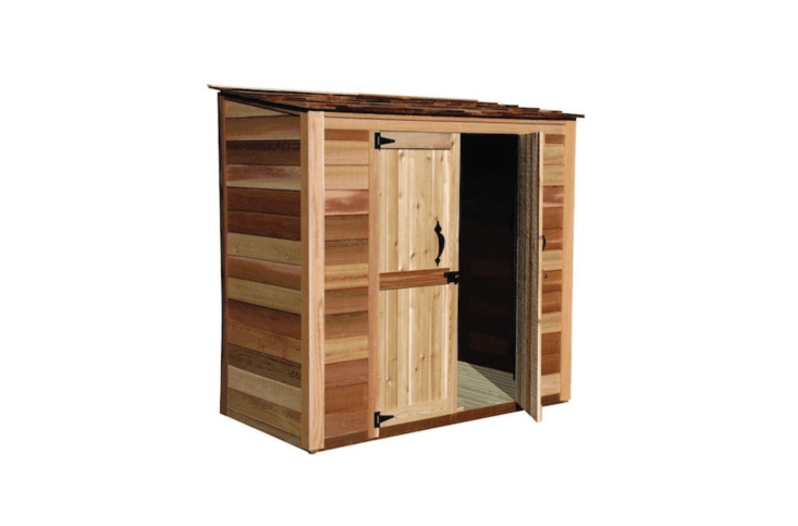 AGrand Garden Chalet made of western red cedar measures 6 feet wide by 3 feet deep (and is 7
