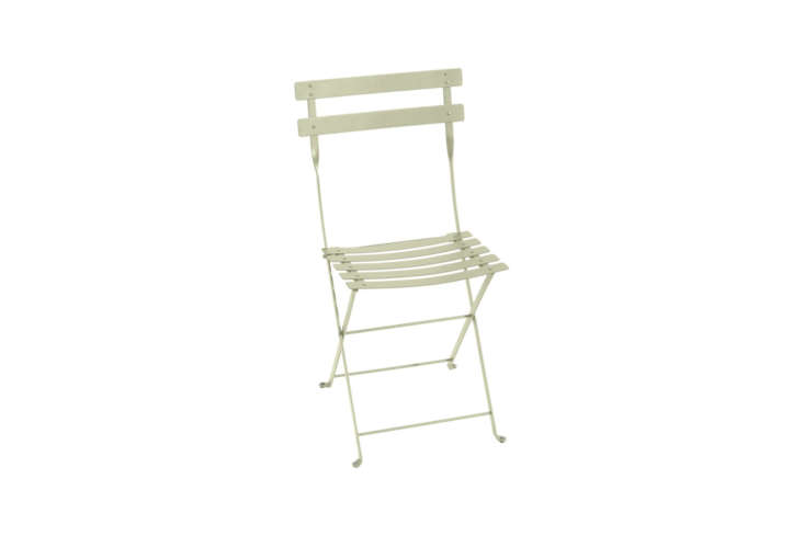 The Fermob French Bistro Folding Chair is available in a few shades of green, one of which is Willow Green as shown. A set of \2 is \$\23\2 at Horne.