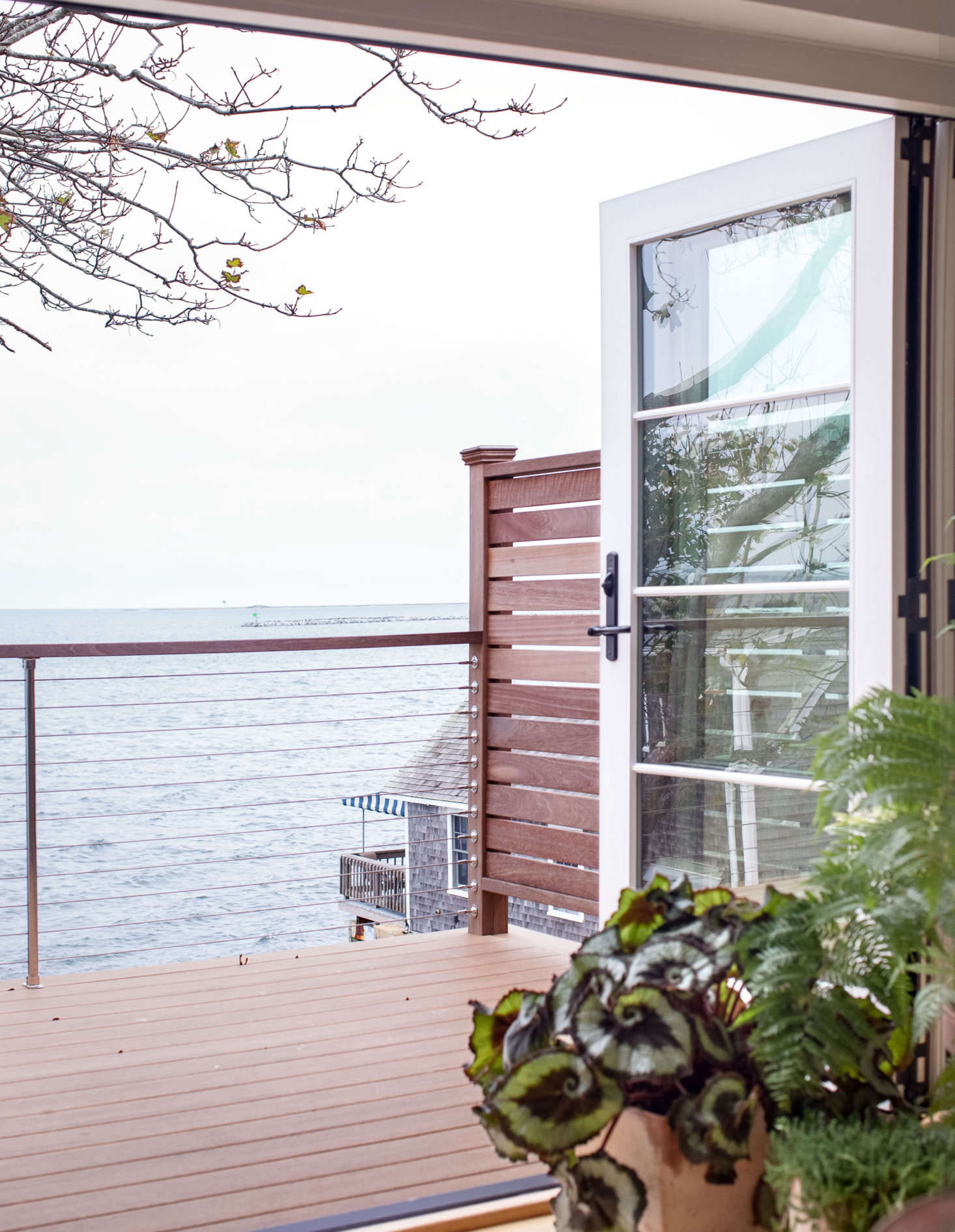 See more of this Cape Cod balcony deck at Out at Sea: A Shipshape Renovation in Provincetown by Hein+Cozzi. Photograph by Justine Hand.