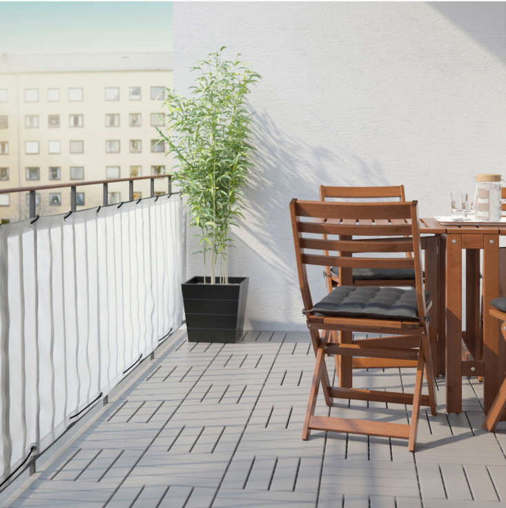 The Ikea Dyning Balcony Privacy Screen in White is the same composition and measurement as the design in black (above), but with a lighter, more translucent look; \$\14.99.