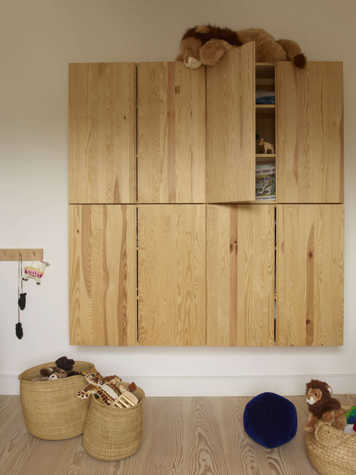 One of our favorite Ikea storage lines, the Ivar wall unit is perfect here for a child&#8