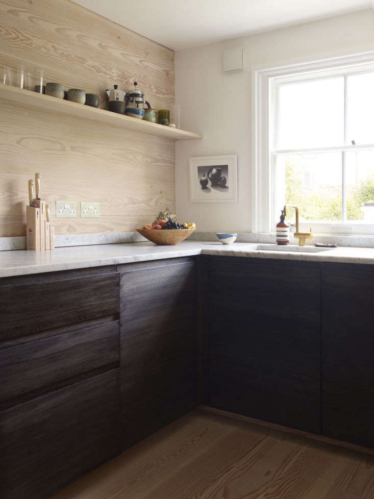 In Lisa Jones&#8\2\17;s remodeled London kitchen,cabinets are Ikea boxes paired with custom cabinet fronts fromNaked Doors. Photograph by Richard Round-Turner, courtesy of Lisa Jones.
