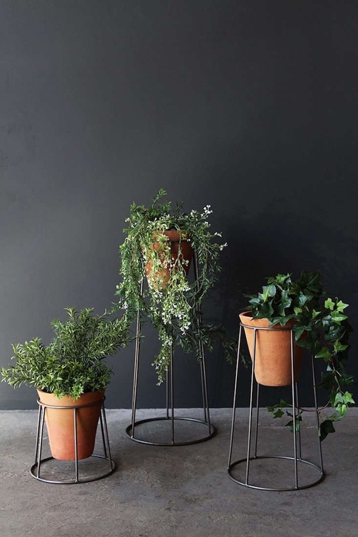 A set of three Iron Standing Pot Holders & Pots is £80 from Rockett St George.