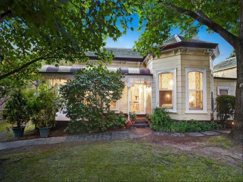 Before the Cheongs moved in, the house was painted yellow and had a patchy front lawn. Photograph via Real Estate.